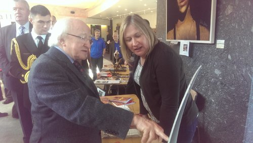 President Michael D. Higgins talks to Edel Kelly, INOU at the Men's Shed International Conference earlier today