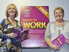 Minister holding Working for Work book with Ann Fergus, Chair NEC